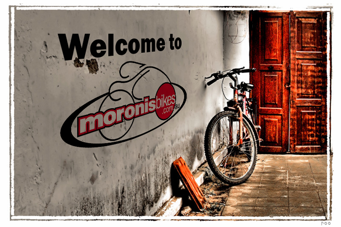 Welcome to Moronis Bikes, opening image. Consists of text and a image of a bicycle and a door.